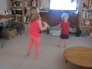 My girls shaking it to Smurfs Dance Party!